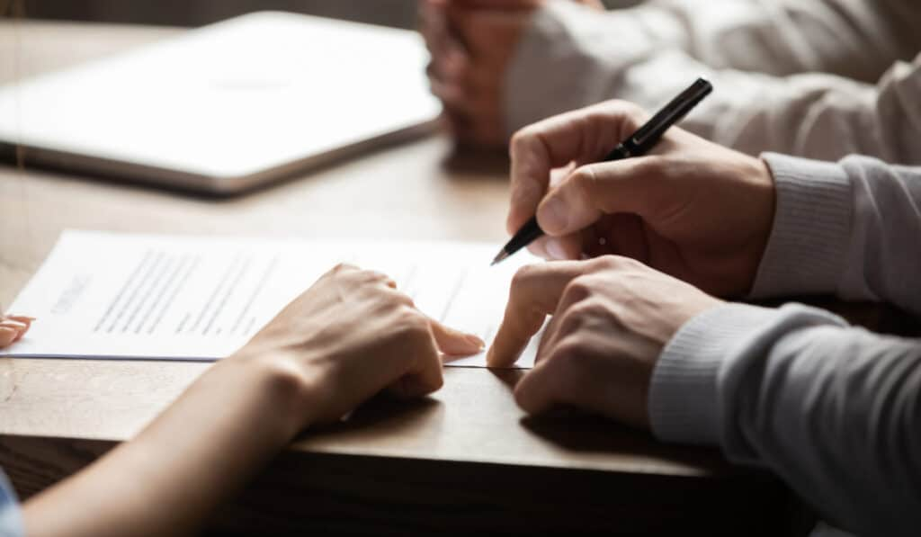 employee signing termination paperwork with HR